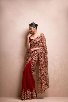 a deep wine tulle sari with intricate antique gold hand embroidered jaal embroidery & stylised floral bunches at the hem from Shyamal & Bhumika Spring 17 collection Red Lehenga, Bridal Lehenga, Lehenga Choli, Anarkali, Blue Saree, Net Saree, Sabyasachi, Indian Dresses, Indian Outfits