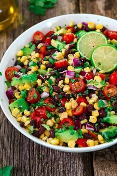 Ingredients for avocado black bean and corn salad mixed together. #salad #saladrecipes #summersalad #healthyrecipes #summerrecipes #healthyeating #healthyfood #fitnesstips