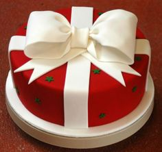 White Bow on Round Red Christmas Cake | Simply Stunning Cake Designs