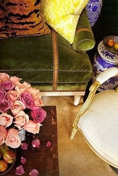 Green velvet, roses, animal print pillows, blue and white garden stools - Jeffrey Bilhuber