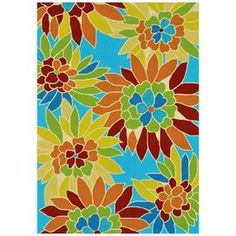 Handmade indoor/outdoor rug with multicolored flowers against a bright blue background.