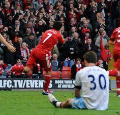 Luis Suarez celebrates after scoring against Aston Villa at Anfield