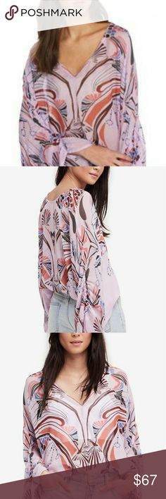 Free People NWT Beneath The Sea Top Printed with shell-inspired swirls, this lovely semi-sheer chiffon blouse features a deep V neckline and billowy angel sleeves with a bit of ruching. Easy pullover style with elastic at the waist.  100% viscose, machine washable.  Sold out at FP and sells full price at other online retailers.  Size large, color is lilac. Available in other sizes and colors,  please see my closet. Free People Tops