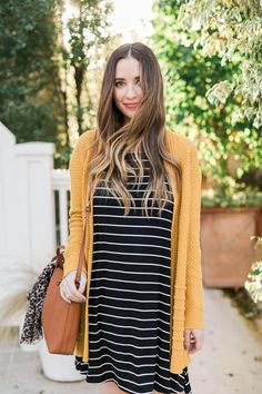 Stitch fix: I bought a mustard yellow cardigan and need cute dresses to pair with it Mustard Cardigan / Black Striped Dress / Camel Leather Shoulder Bag Mustard Cardigan Outfit, Yellow Cardigan Outfits, Striped Dress Outfit, Mustard Yellow Cardigan, Dress With Cardigan, Dress Outfits, Fall Outfits, The Dress, Cute Outfits