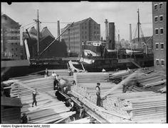 BB52/02222  Men unloading timber at Gloucester Docks, 1920 - 1940. Photographer: Sydney A Pitcher. Click for more information, or to search the collection. Gloucester Docks, Photographer Sydney, Info Graphics, Historical Images, New York Skyline, Times Square, England, Search, Travel