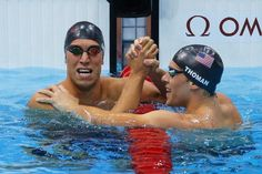 Day Three - JULY 30: (L-R) Matt Grevers of the United States and Nick Thoman of the United State celebrate after Grevers won and Thoman finished second in the Final of the Men's 100m Backstroke on Day 3 of the London 2012 Olympic Games at the Aquatics Centre on July 30, 2012 in London, England. (Photo by Cameron Spencer/Getty Images)