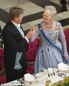 Cheers! King Willem-Alexander and Queen Margrethe clink glasses...