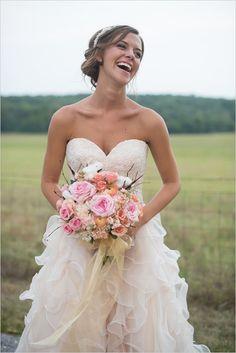 romantic bridal attire with pink bouquet