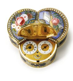 The See-Saw A GOLD ENAMEL AND PEARL TREFOIL MUSICAL AUTOMATON SNUFF BOX WITH WATCH FOR THE CHINESE MARKET THE MOVEMENT ATTRIBUTED TO PIGUET & CAPT GENEVA WITH BOX MAKERS' MARKS FOR RÉMOND, LAMY, MERCIER & CO., 1804-1811