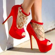 Red high heels with gold chains
