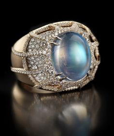 Moonstone and Rose gold ring  The amazing rainbow moonstone at the center of this ring is decorated with 12 diamond tentacles holding the moonstone and floating above a finely set bed of 542 diamonds in 18 karat rose gold.