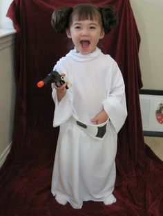Princess Leia homemade costume!  I used pony tail hair extensions for her hair and foam craft paper with Velcro for her belt.  She likes dressing up as a princess, too, so I use the hair extensions for her up do's.