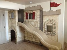 Castle playhouse with slide!!  How fun for a kids play area in the basement!
