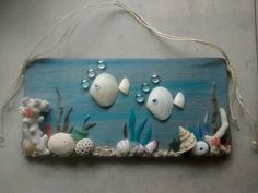 Wall art witg shells and rock. Could be done with crystal sea horse, or sea glass sea horse.MBs