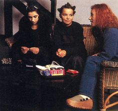 Tori Amos, Bjork, and PJ Harvey hanging out together on wicker furniture
