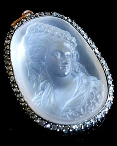 Moonstone cameo pendant, French, 1870s. Moonstone, rose-cut diamonds, silver and gold.