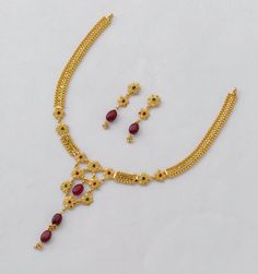 Wonderfully detailed mini mala necklace with dot-mina and Indian ruby beads holding together a colourful bunch of flowers. Crafted with routine economy in hallmarked 22K gold by your trusted Gold Factory.  Necklace : 10 gm, price Rs.32,200/- Earring : 3 gm, price Rs. 10,000/-
