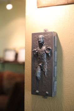 I love this but it is FAR too expensive.    Star Wars Han Solo in Carbonite Light Switch $40