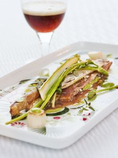 Asparagus with crispy lamb brisket and wild garlic mayonnaise:  This dish was created by top Swedish chef Paul Svensson. Paul Svensson is known for his work as creative leader at the Michelin-starred restaurants Fredsgatan 12 and Bon Lloc in Stockholm.