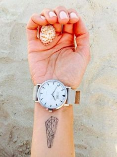 This geometric tattoo looks greta paired with a chunky watch.