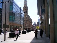 New Cathedral Street, with the Royal Exchange (centre), looking south towards St Ann's Church (behind tree). Rebuilt since the 1996 IRA bombing of the city centre