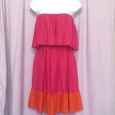 Max & Cleo Jennifer Dress NWT!! This fabulous strapless dress has a pleated flounce and pleated hem!  Such a fun dress! Smocked empire waist under flounce. 100% polyester. 28 inches total length. Max & Cleo Dresses Mini