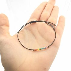 Items similar to Waxed Rainbow Seed Bead Bracelet - Beaded Bracelet - Boho Jewelry - Tie on or Adjustable Closure on Etsy Diy Bracelets Easy, Cute Bracelets, Seed Bead Bracelets, Friendship Bracelets, Lgbt Bracelet, Seed Beads, Diy Crafts Jewelry, Bracelet Crafts, Bracelet Patterns