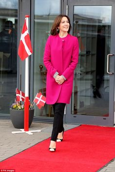 For the occasion Princess Mary wore a fuchsia wool crepe tench coat by GOAT she had previously worn to Queen Margrethe II of Denmark's 76th birthday