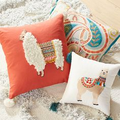 Llamas are typically found in places like Peru, but our llama's giving global drama to your sofa with exotic embroidery, a curly coat—plus pompoms just for fun.