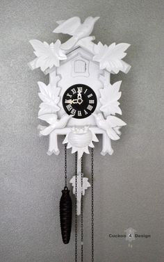 Find an old cuckoo clock on Craigslist or at a thrift store, paint glossy white for a modern look.