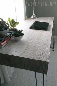 beautiful mcm desk built from upcycled plywood strips. (Whitewash finish method detailed.)