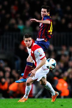 FC Lionel Messi of FC Barcelona duels for the ball with Saul Niguez of Rayo Vallecano during the La Liga match between FC Barcelona and Rayo Vallecano de Madrid at Camp Nou on February 15, 2014 in Barcelona, Catalonia.