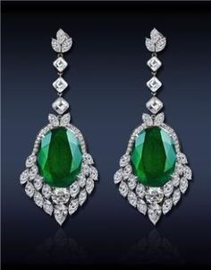 A Breathtaking Drop Emerald Earrings, Featuring: GRS Certified 30.48 Ct Oval Cut Colombian Emeralds (2 Stones), Surmounted by GIA Certified 1.02 Ct D VS2 and 1.00 Ct G VVS1 Round Brilliant Cut Diamonds (2 Stones) Surrounded by 12.53 Ct Mixed Cut Diamonds, All Set in Platinum. Jacob & Co. by julia