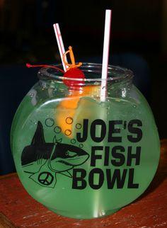Joe's Crab Shack Fish Bowl Recipe.  What you need:  1 ounce coconut rum (Malibu)  2 ounces banana Schnapps (99 Bananas)  1 ounce Bacardi light rum  1 ounce Midori  38 ounces pineapple juice  28 ounces Sprite  2 slices lemons  2 slices limes  2 slices oranges  ice (as needed)