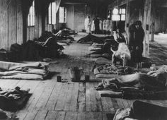 Women prisoners lie on thin mattresses on the floor of a barracks in the women's camp in the Theresienstadt ghetto, between 1941 and 1945.