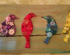 Item details Birds on a Wire 7.5 on Recycled Wood with Acrylic Paint Background. Comes ready to hang. Background color may vary slightly or can be custom ordered. Each piece is one of a kind and buttons may vary but overall design is the same. Dimensions are 7.5 x 14 inches.