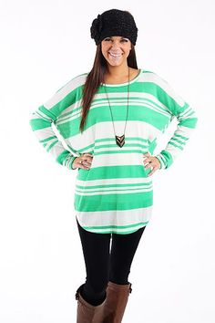 "Bold Lines Top, Green $35.00 We are loving the gorgeous green color and not to mention the stripes:) This is a throw and go top for sure...just add leggings for a simple and super comfy outfit!   Fits true to size. Miranda is wearing the small.    From the shoulder to the hem:  S-28""  M-29""  L-30"""