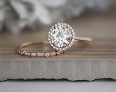 ****Engagement Ring Details**** 14k Solid Rose Gold (Also can be made in White and Yellow Gold, Please select your choice At Checkout) 1.5-1.6mm (Approximate Band Width) Natural Moissanite (Center Stone, Charles & Colvard Certified Forever Brilliant) Round 9mm (Dimensions of Center