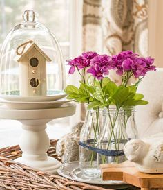 So easy and so pretty!  Tie three glass bottles together with twine and fill them with simple faux flower picks from the dollar store to make a simple spring or summer vignette. | Worthing Court Blog