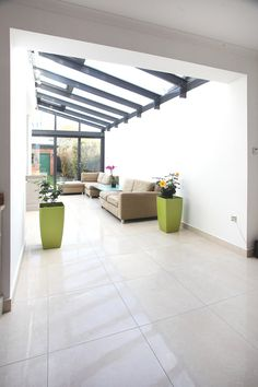 Modern glass and aluminum conservatory extending an English home - Pursuitist