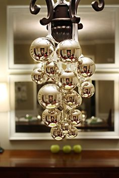 Cut 4 ribbons of various length and string ornaments onto it.  Fold your ribbon in half and slip the smallest ornament through one of the ends.  It will end up on the bottom as your 'support ornament'.  Increase the size of ornaments are you go.