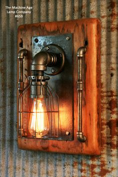 Vintage industrial barn wood wall sconce, light or lamp. Made in the USA from Re-purposed MN barn wood. Steampunk Furniture, Vintage Industrial Furniture, Steampunk Lamp, Industrial Lamps, Industrial Style, Vintage Industrial Lighting, Steampunk Design, Industrial Design, Pipe Lighting