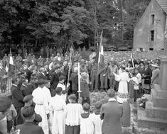 U.S. Army bandsmen (left, background), attend with French civilians the Bastille Day services held in a church cemetery in the liberated village of Castilly in Normandy, France on July 19, 1944. (AP Photo/Harry Harris)