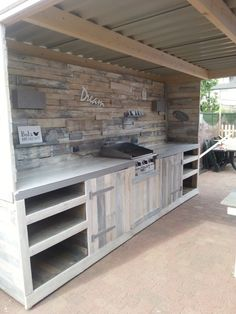 Outdoor kitchen and wall made of recycled old pallets.