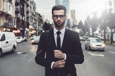 Man in full suit adjusting his sleeve — Stock Image #113835324