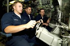 Machinist's Mate Fireman Ricky Andes sits the helm station as he steers the Los Angeles-class attack submarine USS Toledo (SSN 769) .