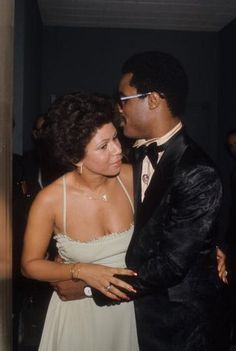 Minnie Riperton and Stevie Wonder chatting at a party in 1975. Photo: Michael Ochs Archives/Getty.