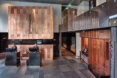 Radisson Blu Riverside by Doos Architects, copper in reception.