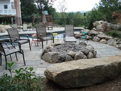 building a firepit with patio around it | ... popular items today that is added to a new patio is a fire pit in this
