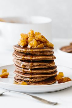 These paleo apple cinnamon pancakes are autumn's most scrumptious breakfast treat. They're light, fluffy, and filled with apple sauce and fresh cinnamon. Top them off with my homemade maple apple cinnamon topping for a sweet crunch in every bite. Raspberry Smoothie, Apple Smoothies, Classic Pancake Recipe, Dairy Free Pancakes, Paleo Pancakes, Freeze Pancakes, Berry Compote, Cinnamon Apples, Cinnamon Club